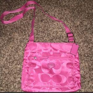Coach pink cross body bag.